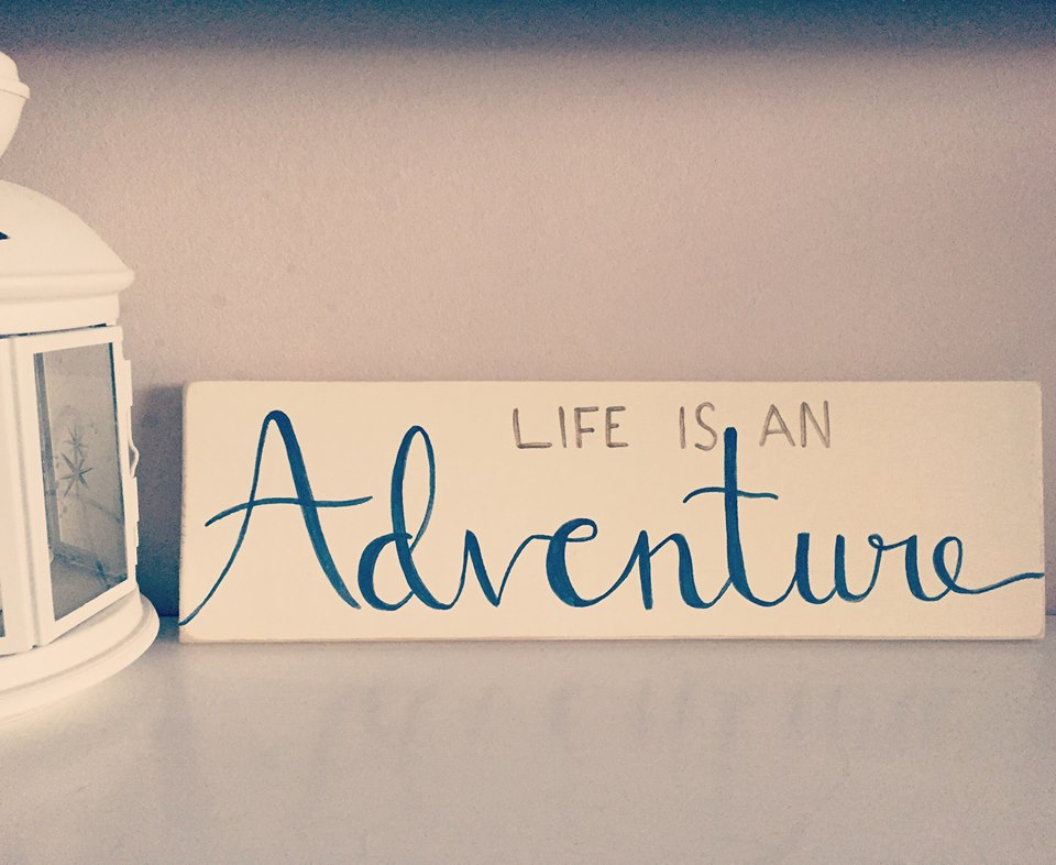 life is an adventure painted sign